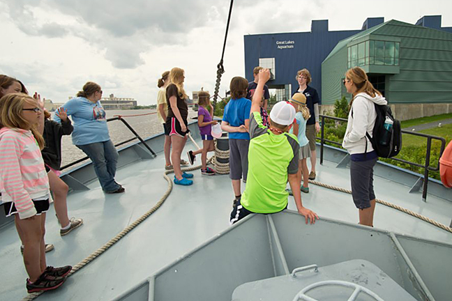 A group of students aboard the Blue Heron research vessel