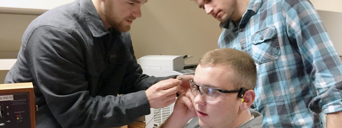 Students testing ear plugs