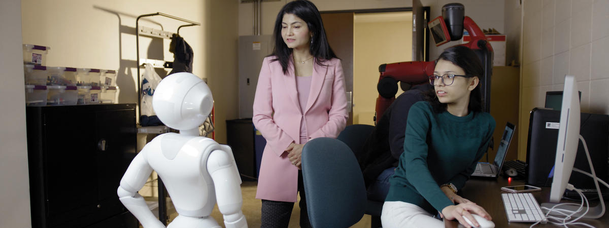 Arshia Khan and robot Pepper