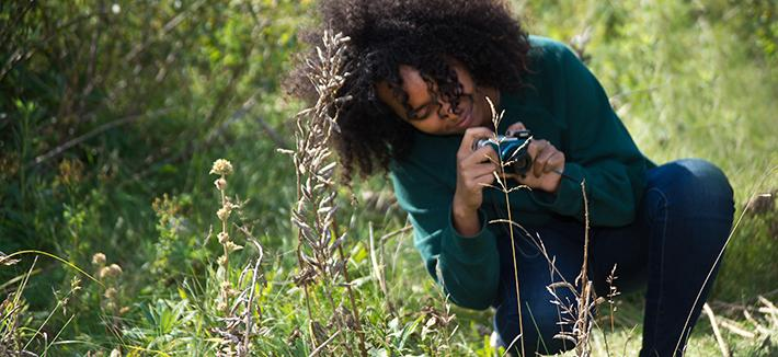 Student Taking Plant Photo