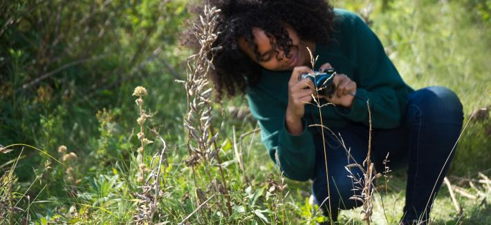 Student photographing plants