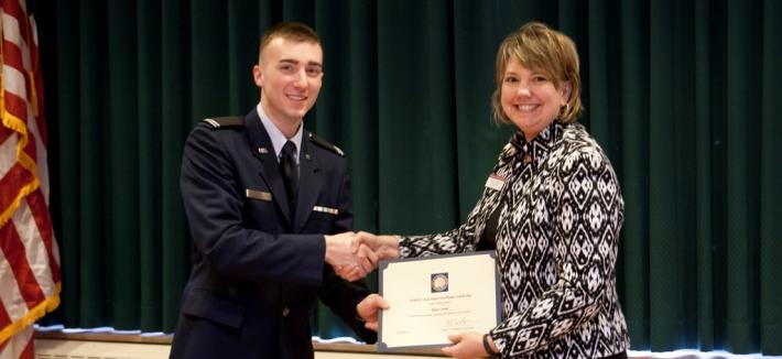 Carrie Sutherland presenting scholarship to ROTC cadet