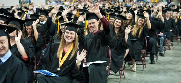 Grads waving at camera
