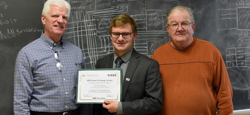 Student receiving award