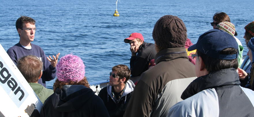 Graduate students hearing from an LLO professor on board the Blue Heron