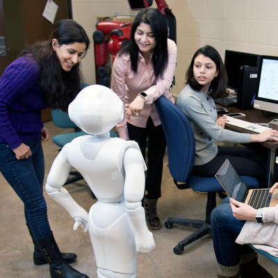 Students programming robot