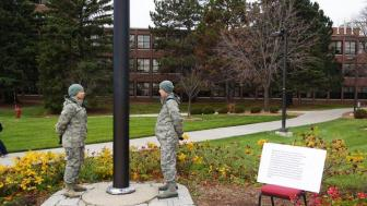 cadets stationed at flag pole
