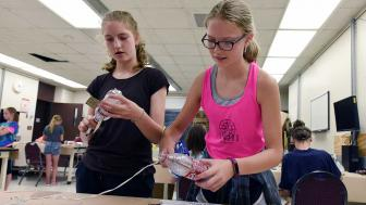 Girls Making Water Rockets