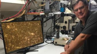 Bob Sterner with microscope