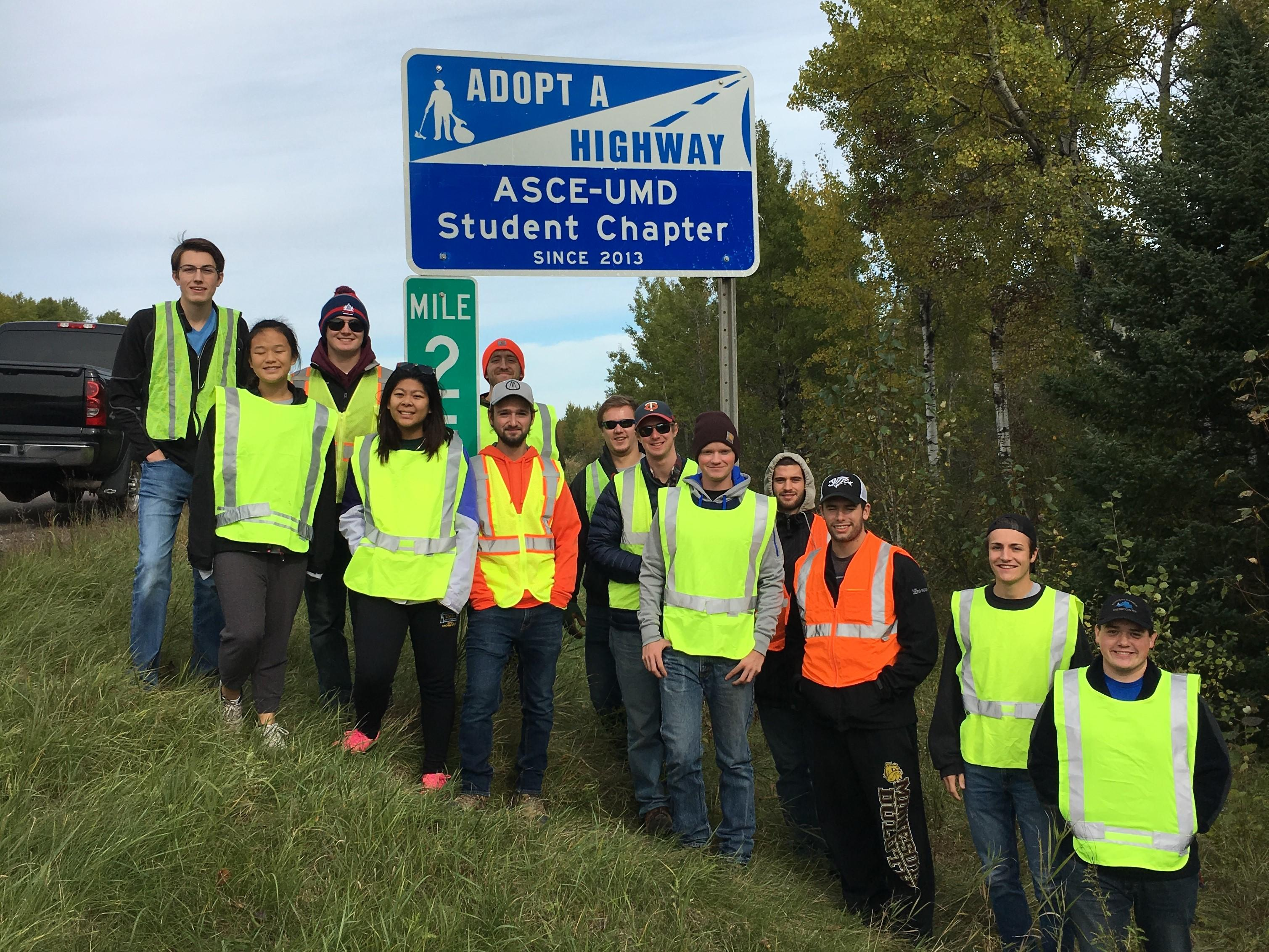 UMD ASCE students with the Adopt-a-highway sign