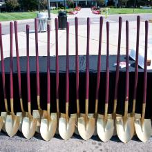 gold shovels for ground breaking in a line