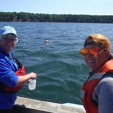 Sandy Brovold and Kaitlin Reinl working in the Apostle Islands on algae blooms