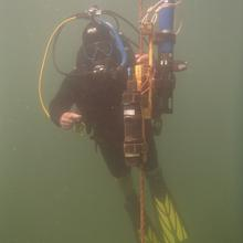Underwater scientific mooring with diver, Meyers Beach Apostle Islands, looking at Lake Superior algae blooms